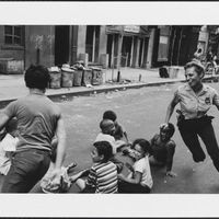 A police officer playing with children in New York, 1970