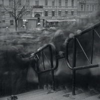 Long exposure of a crowd near the entrance to the Vasileostrovskaya subway station in