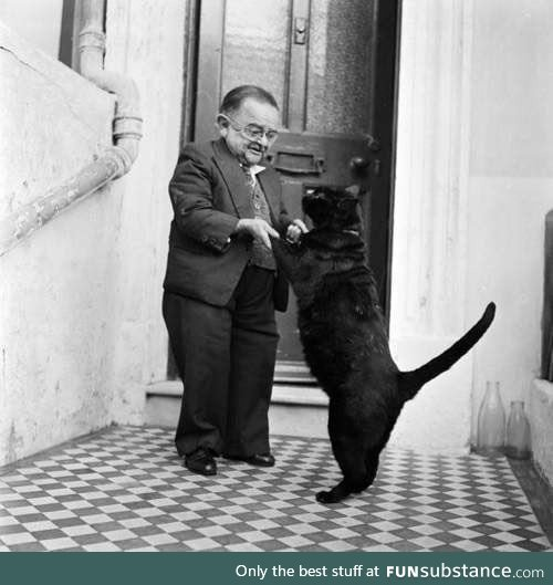 World's smallest man in 1956, Henry Berhens, dancing with his cat