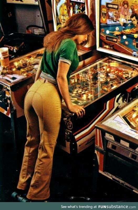 Woman playing pinball (1978)