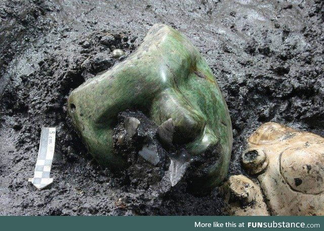 A 2000 years old green serpentine stone mask found at the base if an ancient pyramid in