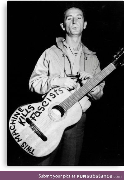 Woody Guthrie and his guitar, roundabout 1941's