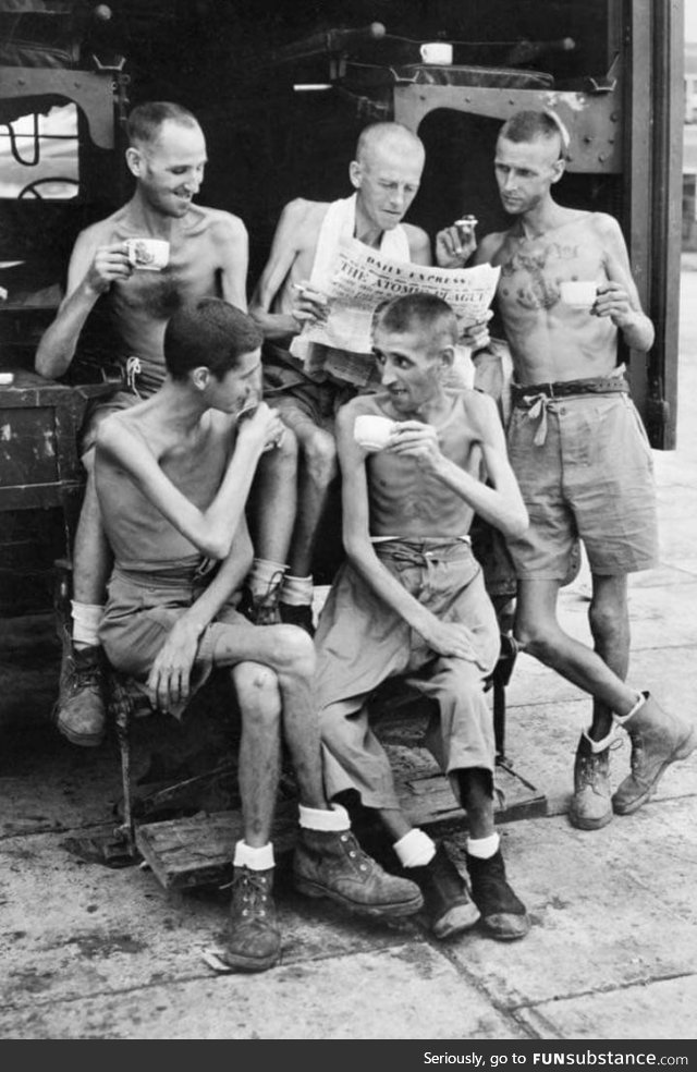Australian prisoners of war enjoying tea after releasing from Japanese captivity at the