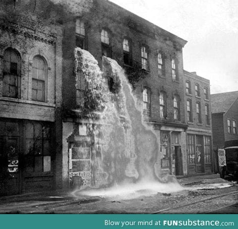 Illegal alcohol being poured out during the Prohibition. (Detroit, 1929)