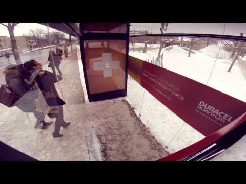 Passengers heat this bus shelter by holding each other's hands