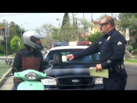 Awesome cop pranks people by pulling them over to give them $100