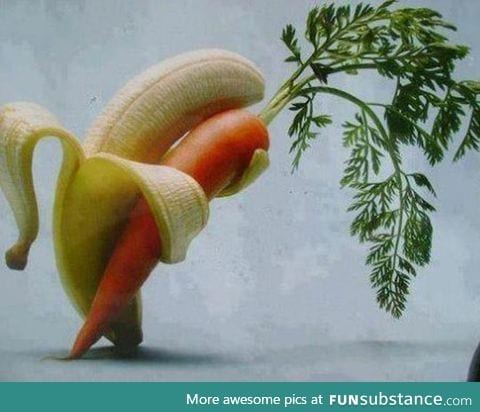 A banana, tenderly holding a carrot