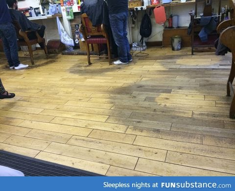 Barbershop floor worn away after decades of barbering