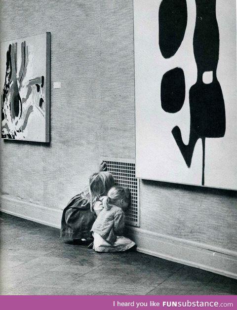 Children not looking at modern art