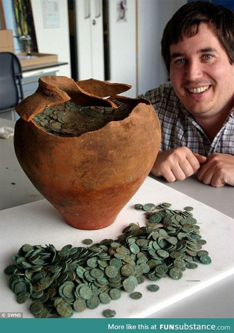 First-time treasure hunter finds 10,000 Roman coins