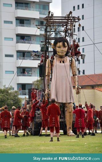 Giant little-girl marionette