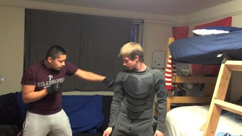 Home made Batman suit blocks multiple punches
