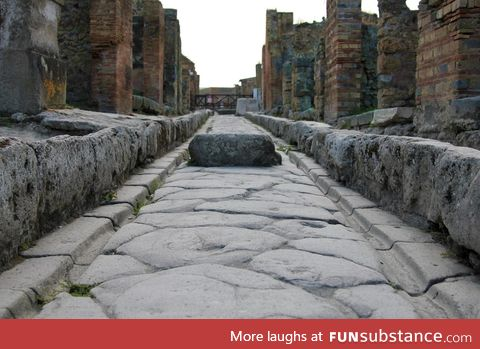Stone street in Pompeii with tracks for chariot wheels