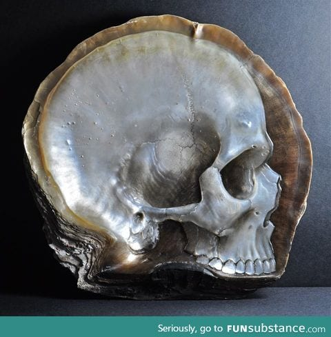 A skull carved from mother of pearl by Gregory Halili