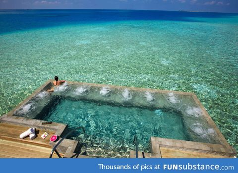 This hot tub is built into the bay!