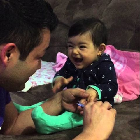 Adorable Baby Fakes Crying When Daddy Tries To Cut Her