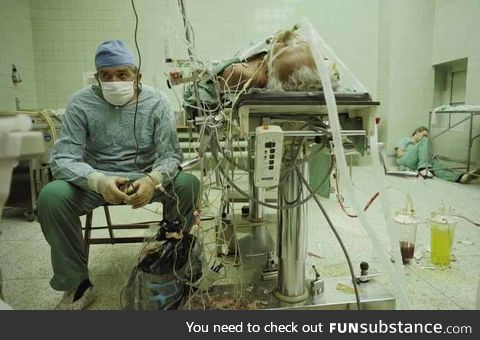 Heart surgeon and his assistant after 23 hour surgery