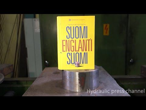Hydraulic press attempts to crush a book, and the book kind of won