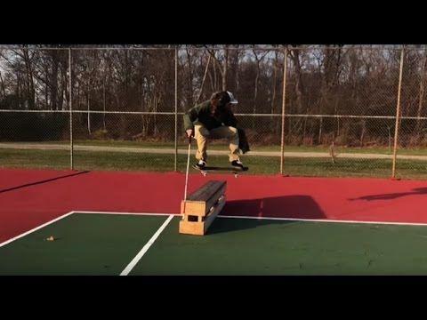 Blind skateboarder using his cane