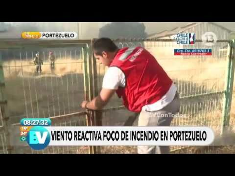 Guy rushes to open gate for firefighters as wind rises a forest fire in Chile