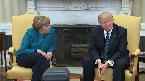 Donald Trump refuses to shake hands with Angela Merkel