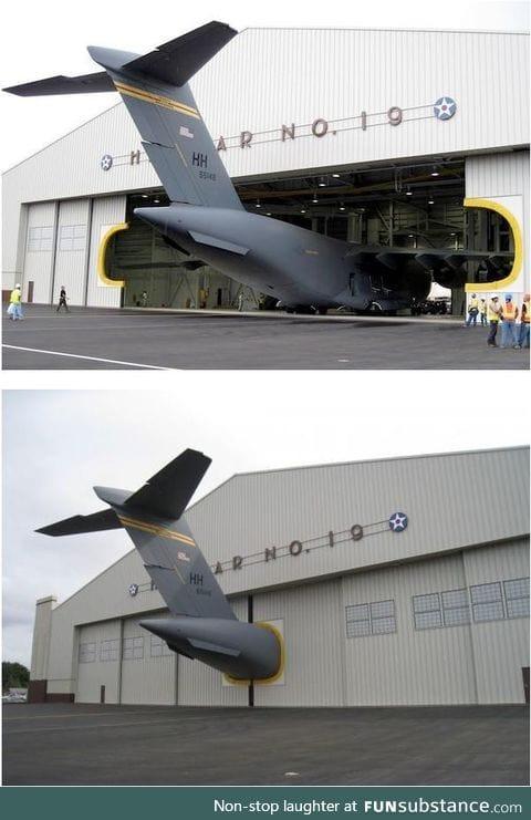 Plane in an undersized hangar