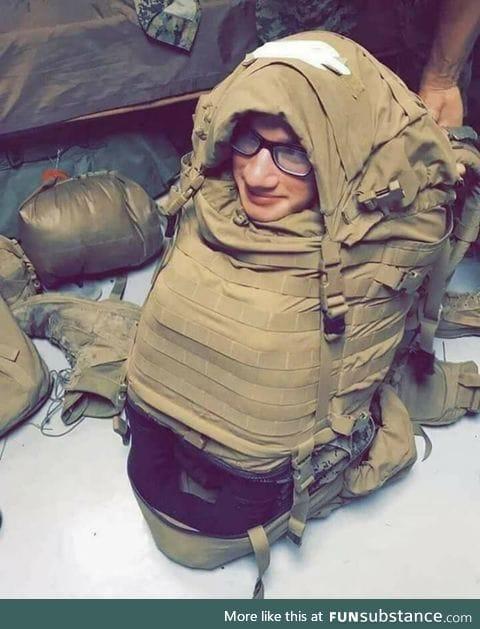 U.S Marine stuffed into a backpack