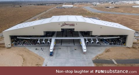 The largest aircraft in the world rolling out of it's hangar in Mojave CA
