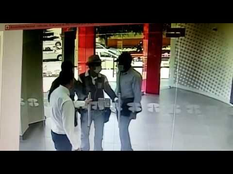 3 guys try to rob a bank, employee locks the door right in their face
