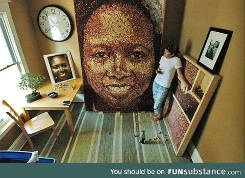 Portrait made out of wine bottle corks. This art is really surprising!