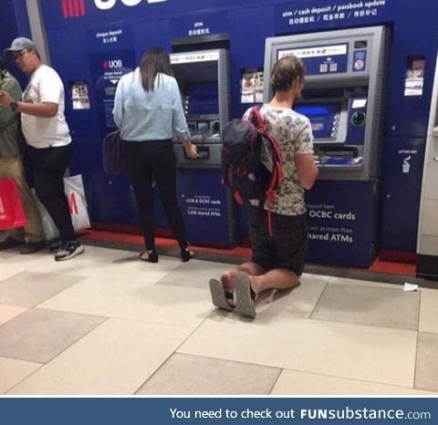Just a German using an ATM machine in South East Asia
