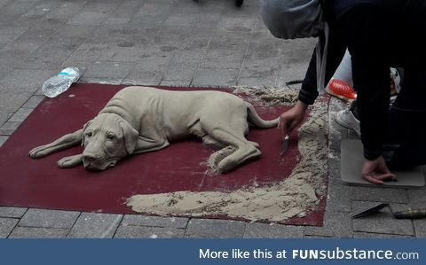 This dog made out of sand. (Germany, Flensburg)