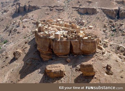 A village in Yemen basically built on top of a huge rock
