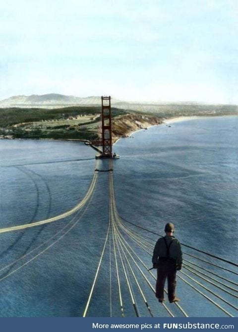 Construction worker standing on the Golden Gate Bridge