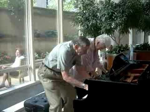 90 year old couple play an impromptu piano duet in the Mayo Clinic lobby
