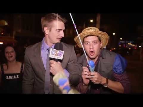 Guys dressed as news reporters for Halloween and interviewed people