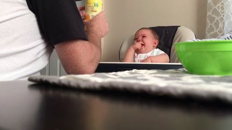 Baby belly laughs at daddy who keeps dropping her snack