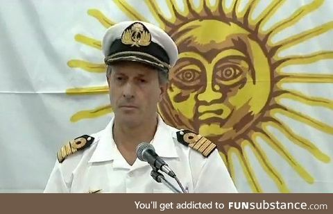 This sun giving a shoulder rub to this navy officer