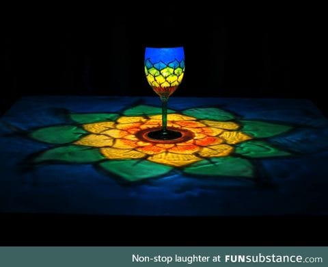 Light through a hand painted wine glass