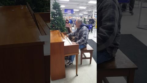 Man walks into Goodwill store and starts playing the piano