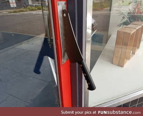 The door handle to this butcher shop