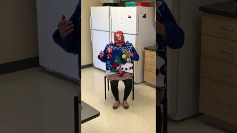 """The winner of our Ugly Sweater contest at work plays """"Carol of the Bells"""" on her sweater"""