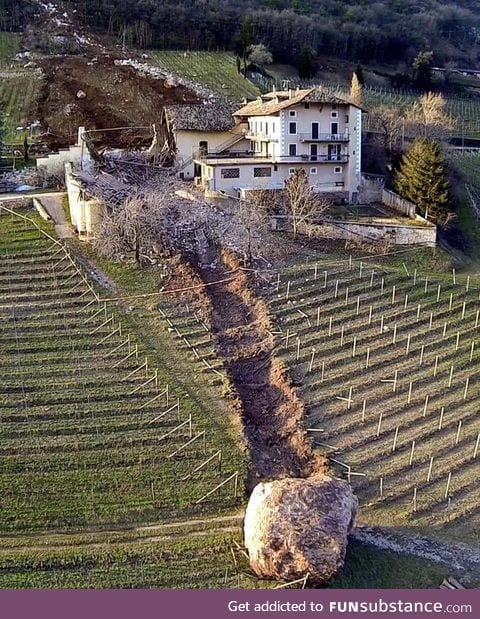 The aftermath of a boulder that rolled through a house in Italy