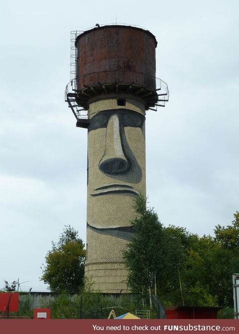 Water tower painted to look like an Easter Island Moai