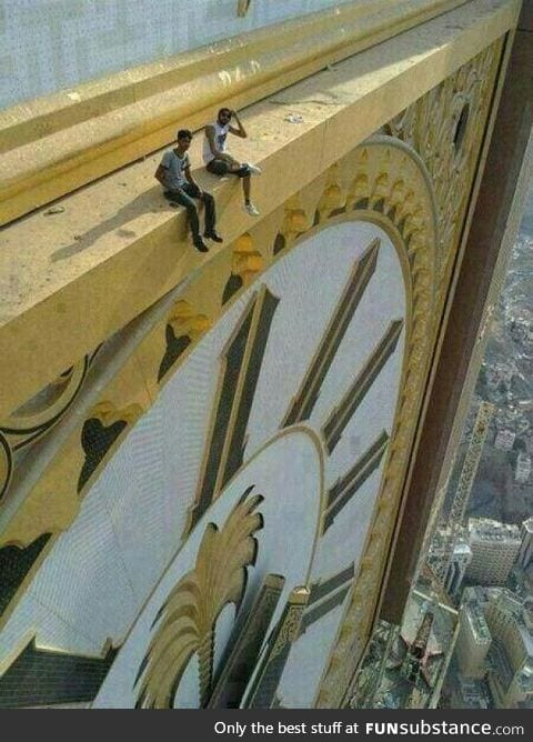 Sitting on top of world's largest clock