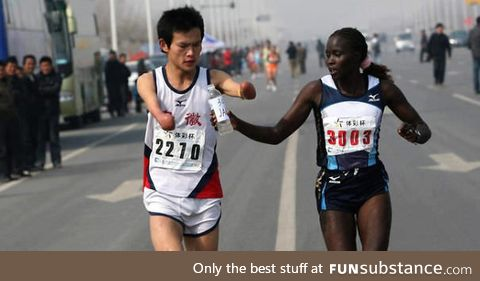 Jacqueline kiplimo helps a disabled runner finish a marathon in taiwan