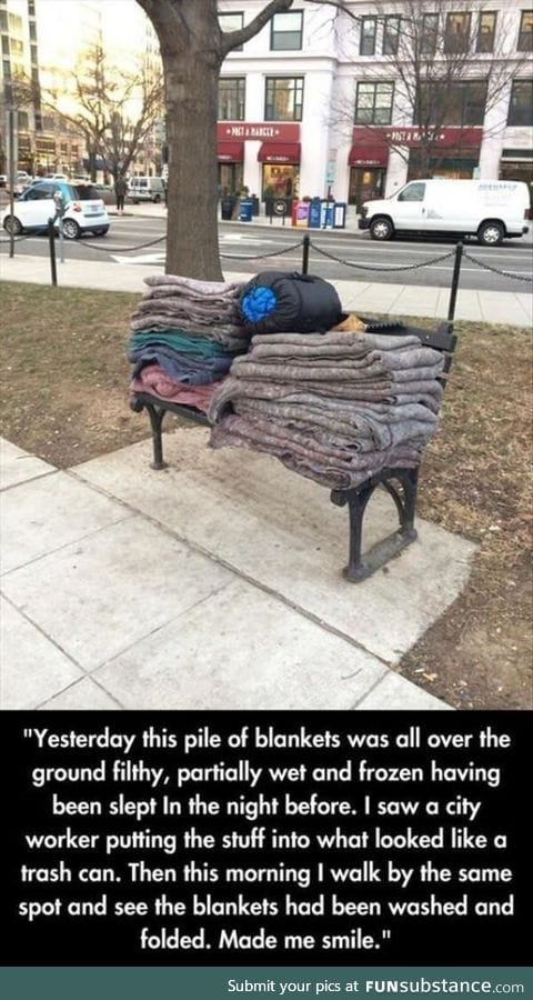 A city worker washes and folds these blankets for the homeless