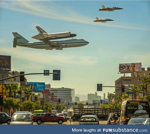 The space shuttle being carried by a 747 and escorted by two F-18's