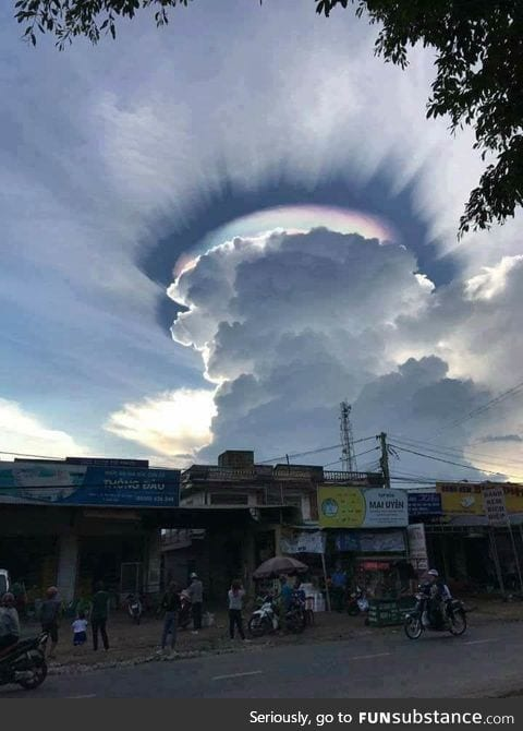 Giant cumulus cloud with iridescence