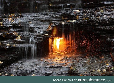 'Eternal Flame Falls' a natural gas jet behind the waterfall burns perpetually